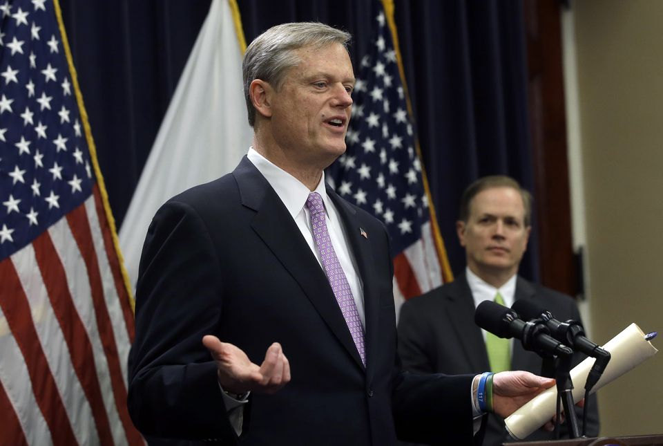 Governor Charlie Baker unveiled his state budget proposal as Mass. Secretary of Education James Peyser looked on, during a news conference at the State House, Jan. 23.