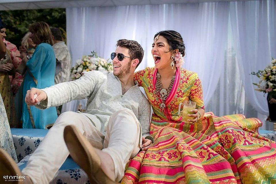 Actress Priyanka Chopra (right) and singer Nick Jonas during the mehendi Friday, a day before their Western-style wedding ceremony at Umaid Bhawan palace in Jodhpur, India.