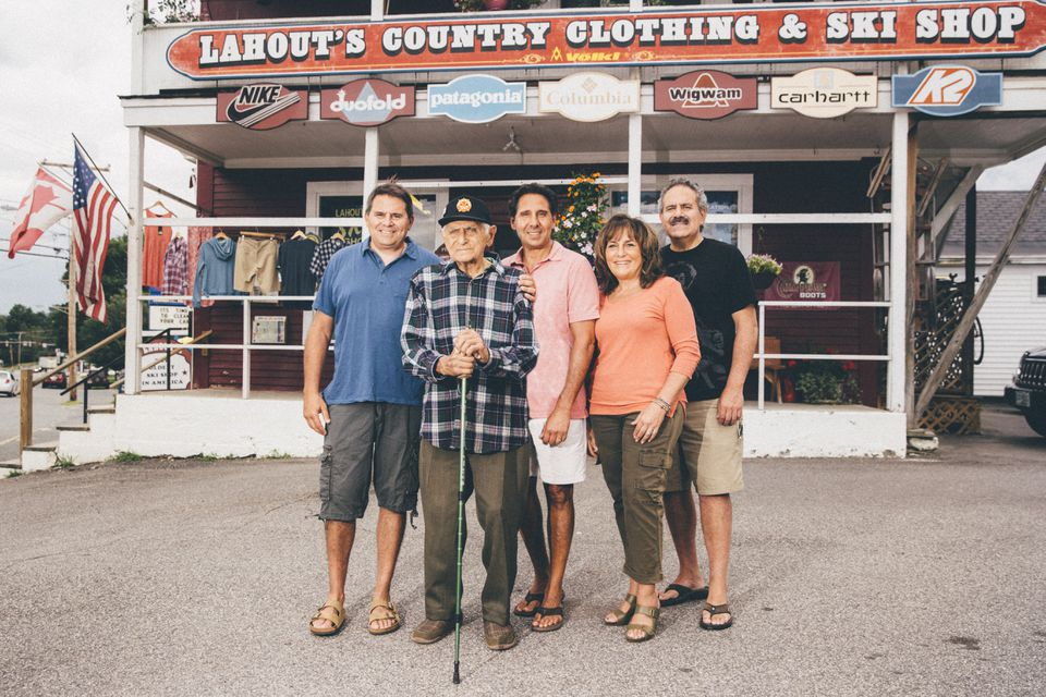 Joe Lahout Sr. (second from left) with his children (from left), Herb, Ron, Nina, and Joe Jr., in front of the Lahout's Ski Shop in Littleton, N.H.
