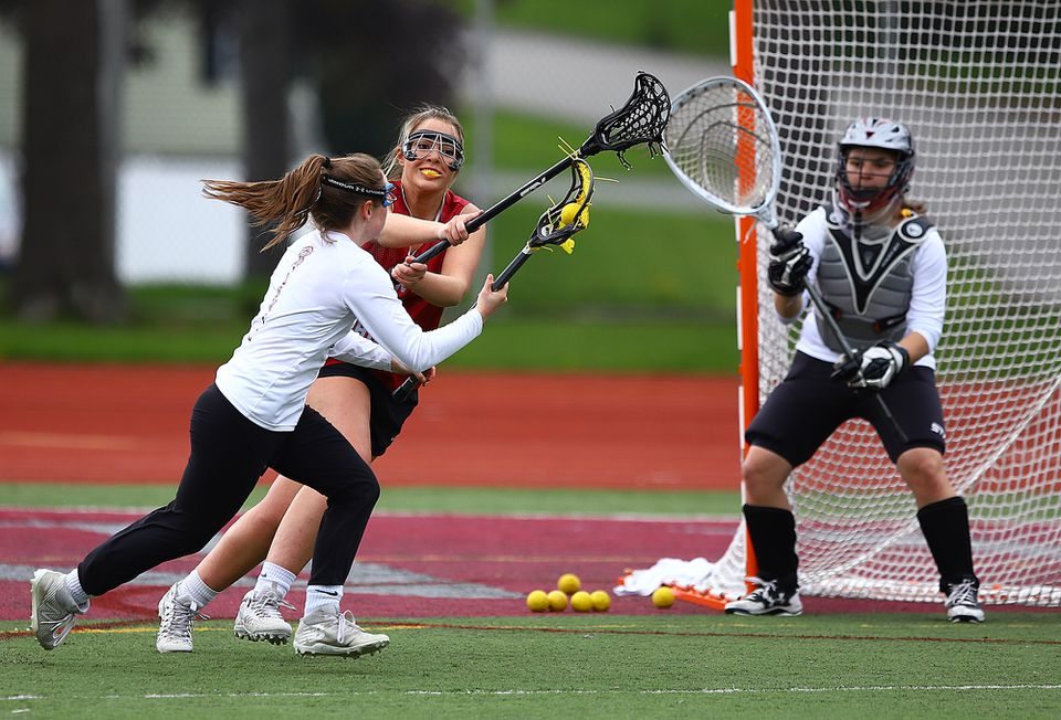 Practice makes perfect as senior captain Olyvia Cassella looks to block this shot during a recent Lowell practice at Cawley Stadium.