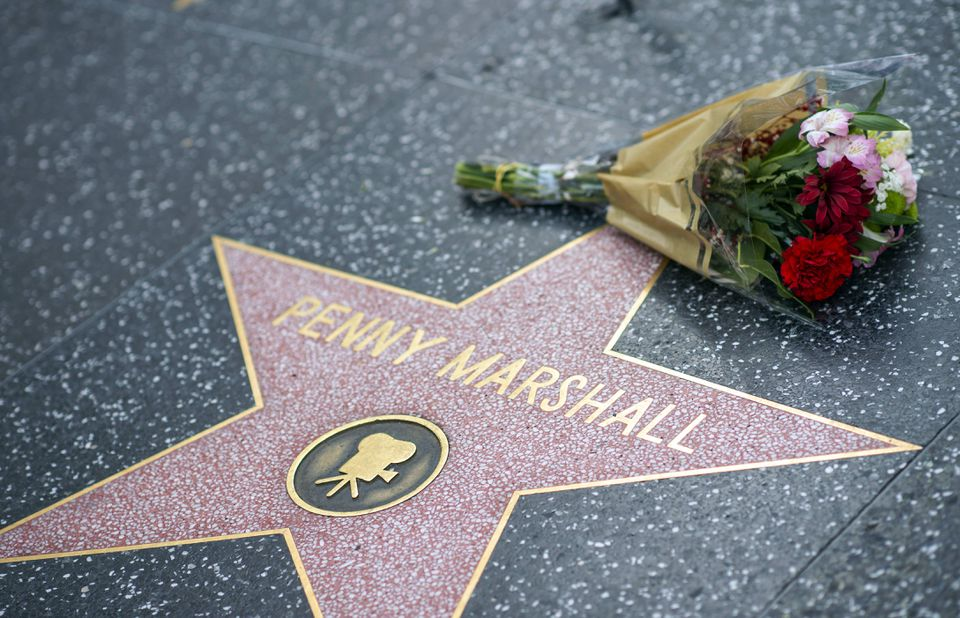 Fans left tributes on Penny Marshall's star on the Hollywood Walk of Fame shortly after the news that Tuesday that Marshall had died at 75.