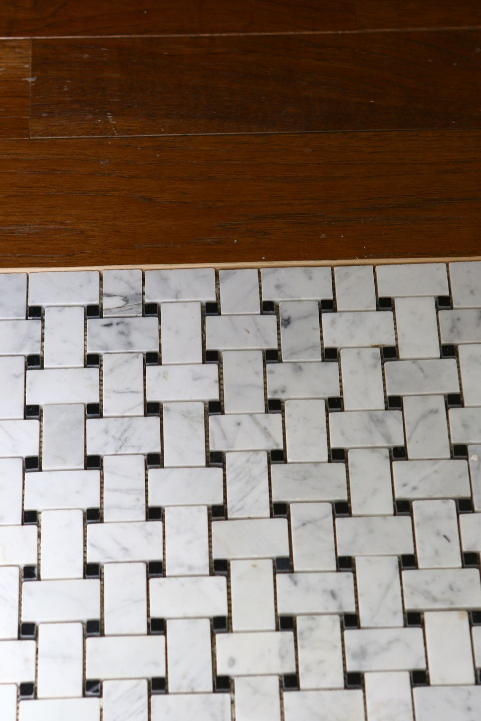 This porcelain basketweave tile in the downstairs powder room is from Roma Tile.