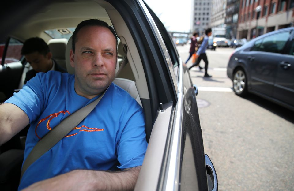 Uber driver Dean Johnson waited for a customer outside South Station on Friday.