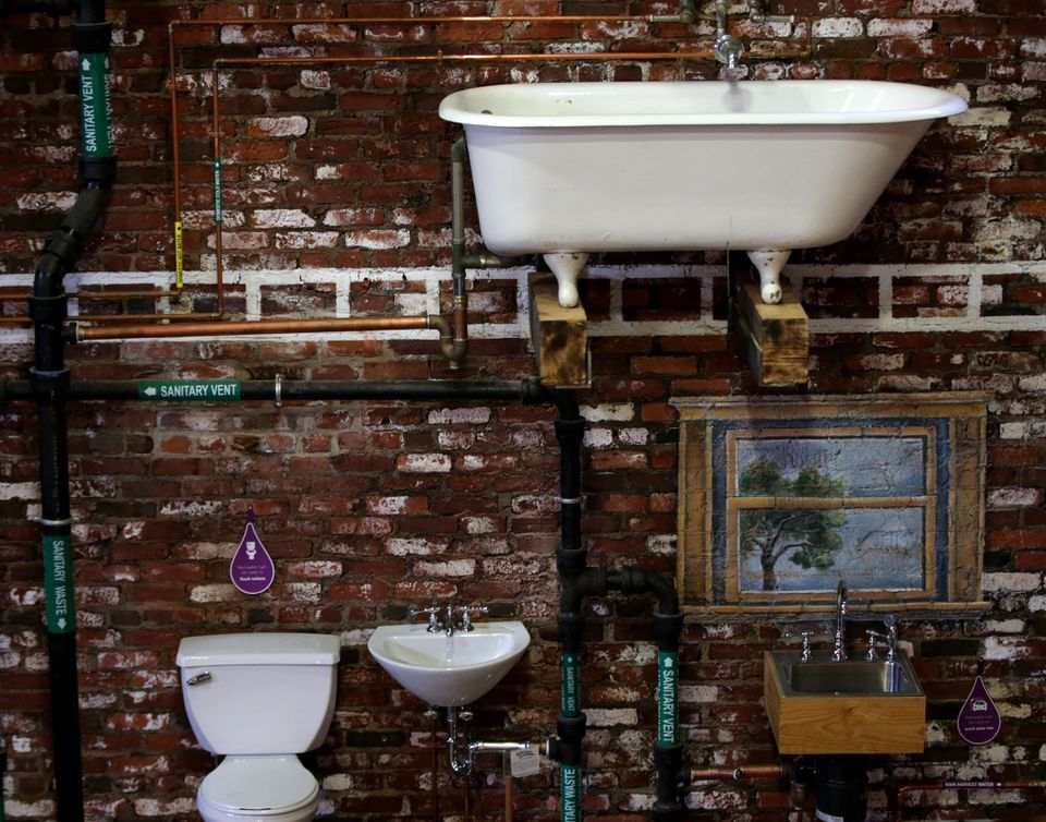A cutaway of the interior of a standard home plumbing system is mounted on a wall of the Plumbing Museum. The display is a favorite of school groups that tour the museum.