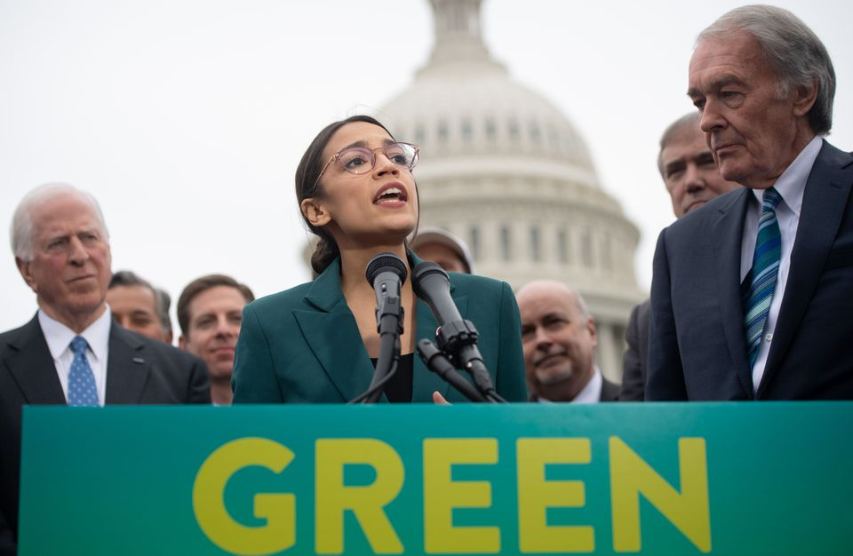 "Representative Alexandria Ocasio-Cortez, with Senator Ed Markey at her side (right), announced ""Green New Deal"" legislation to promote clean energy programs in Washington, D.C., Thursday."