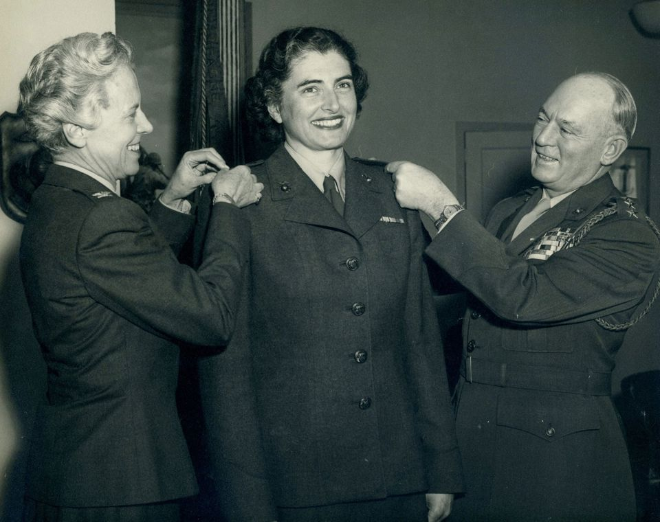 Then-Marine Corps Colonel Julia E. Hamblet (center) at her May 1953 promotion ceremony.
