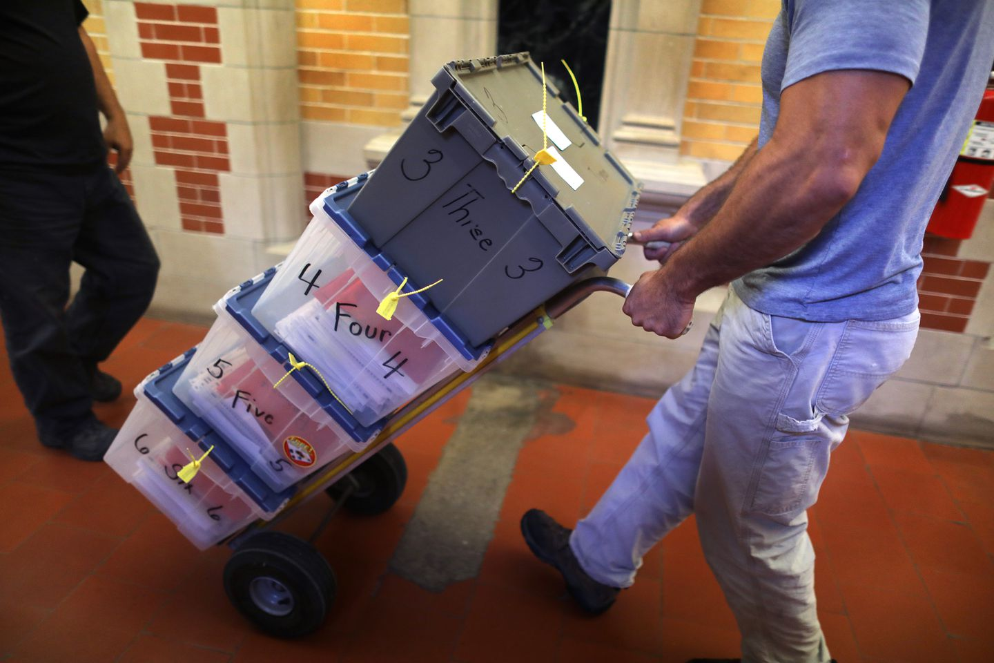 The first load of ballots is rolled down the hall from the city clerk's vault.