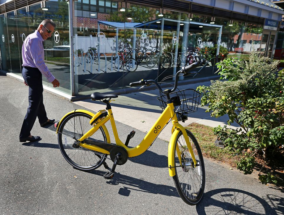 Felice Gammella looked at the Ofo bike at a T-stop in East Boston by Lewis Street.