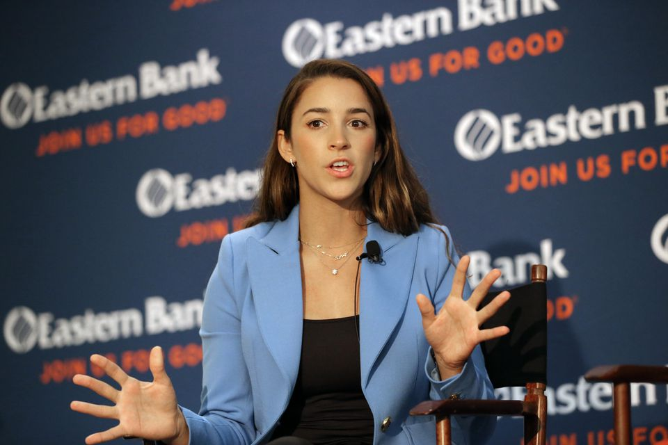 Aly Raisman spoke in the lobby of Eastern Bank's headquarters in Boston Tuesday.