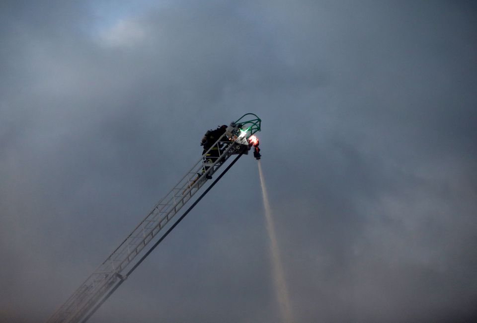 Firefighters poured water on the fire.