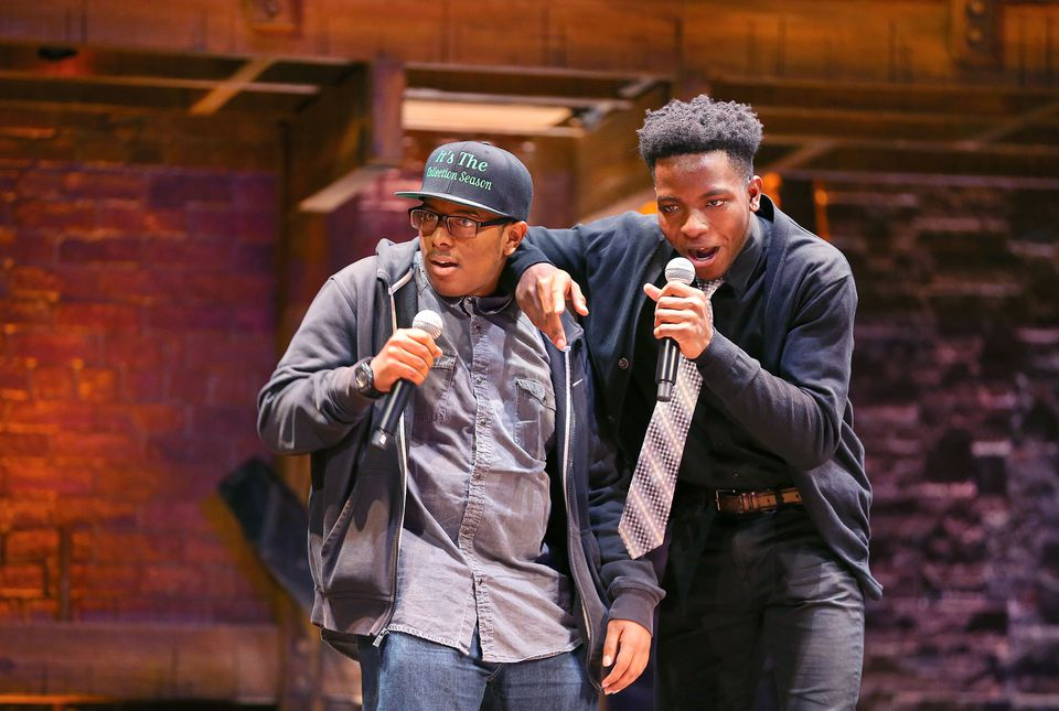 Arius Thomas(at right, left) and Nicolas Adeleye, both seniors at Boston Prep Charter Public School rapped for the audience.