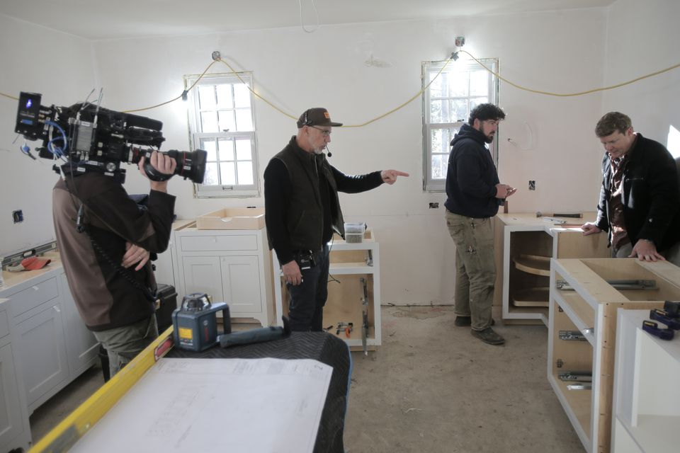 """""""This Old House"""" director Thomas Draudt points out a problem in a shot as the kitchen cabinets are installed back in December. The segments on this project will air on WGBH (Channel 2) beginning on Thursday, March 31, at 8 p.m."""