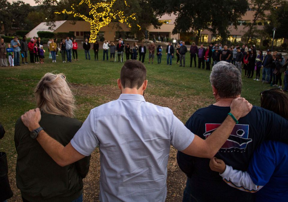 People gather during a vigil Thursday to pay tribute to the victims of a shooting in Thousand Oaks, Calif.