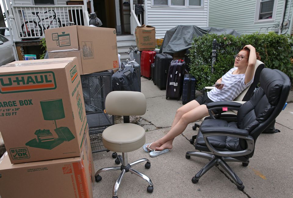 On Wadsworth Street, Boston University student Lina Guo took a break while moving.