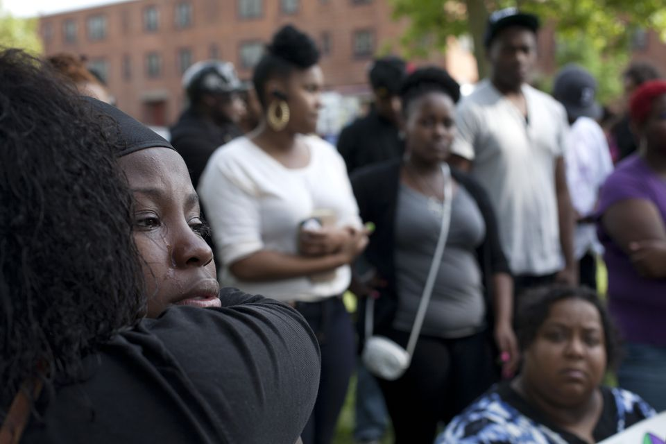 Laya Lesley-Barnes, whose brother Rashad was among five people killed in the city last week, wept during a gathering at Franklin Field in Dorchester on Sunday as participants urged residents to unite for neighborhood safety.