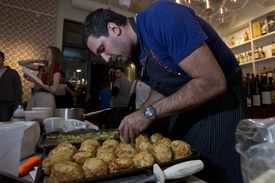 Chef Michael Scelfo from the Russell House Tavern preparing torched Delicata squash with Cabot cheddar biscuits.