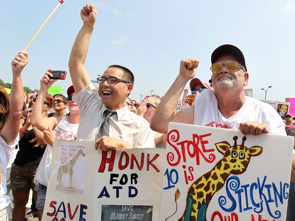 Market Basket employees and customers attend a rally in Tewksbury on Aug. 5.