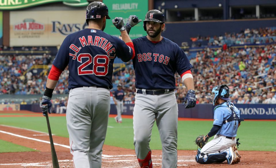 J.D. Martinez congratulates Mitch Moreland after his fourth-inning home run on Sunday against the Rays in St. Petersburg, Fla.