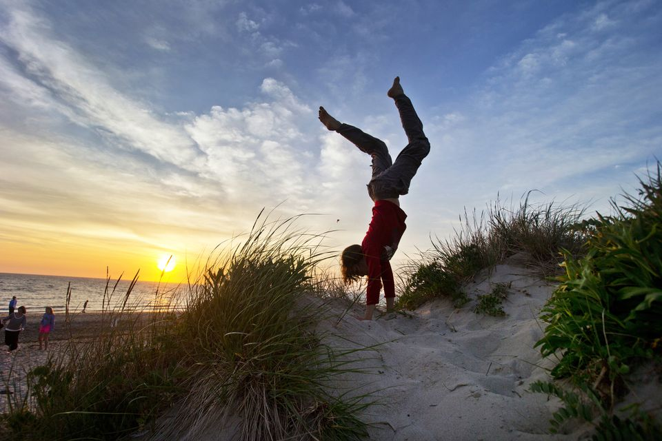 A handstand in the dunes of Wellfleet by Damon Wolf, 13, of New Paltz, N.Y. captures a quintessential Cape Cod moment.
