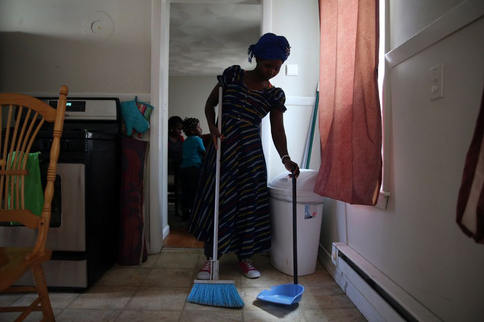 Vanisi Uzamukunda cleaned the kitchen at her home in Lowell.