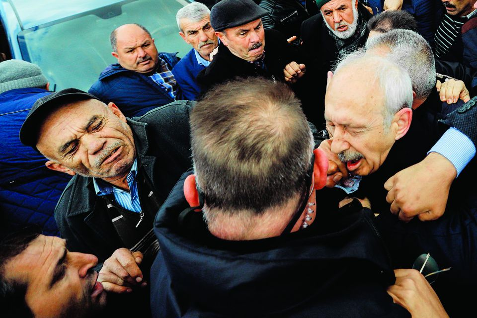 The chairman of the Republican People's Party Kemal Kilicdaroglu (right) was attacked by a protester Sunday.