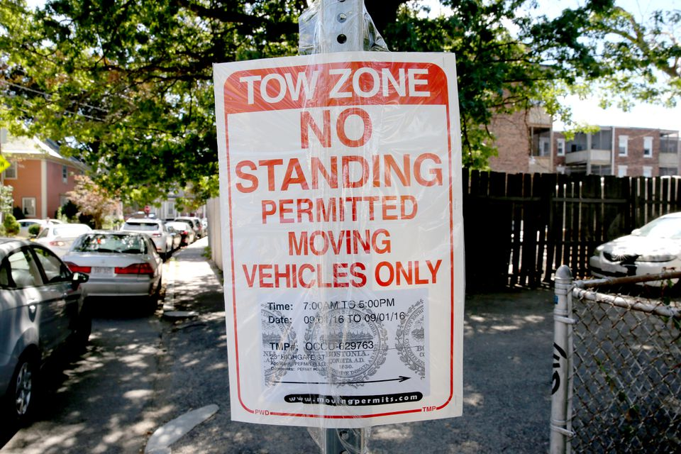 A moving truck sign on Highgate Street in Allston reserved a parking space on Sept. 1, 2016.