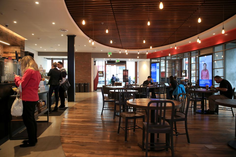 """The Capital One Cafe combines a Peet's Coffee shop with """"digital lifestyle coaches"""" to help customers with their online banking services."""