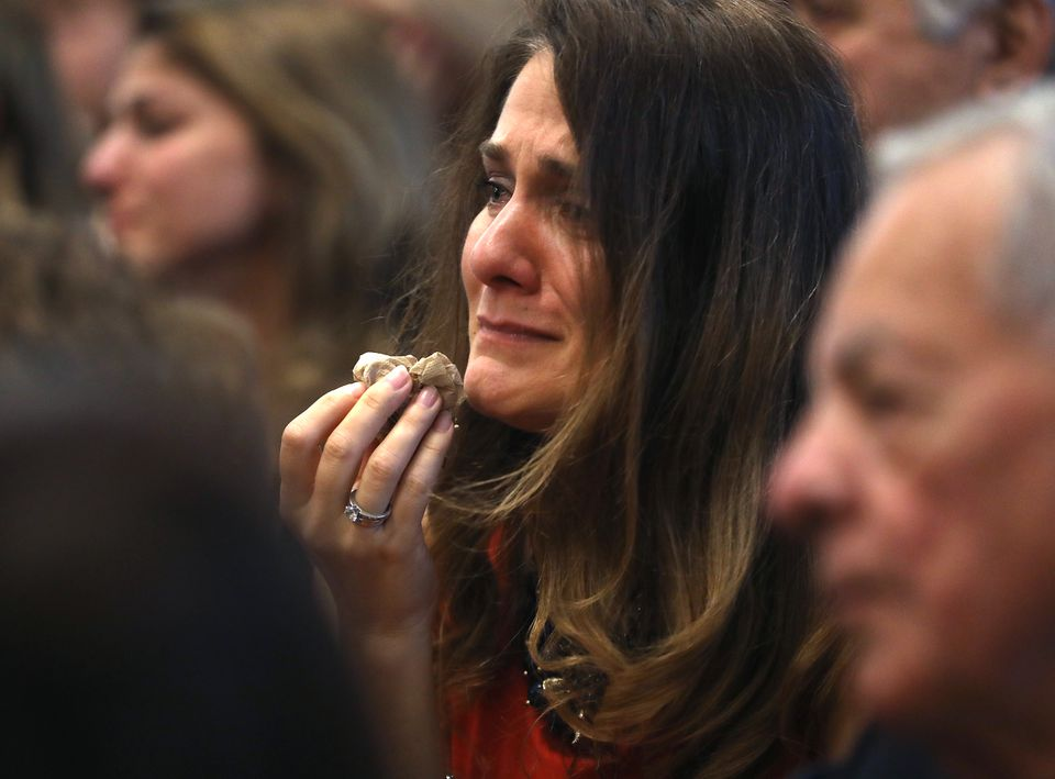A woman cried Sunday at St. Athanasius the Great Church as Rev. Nicholas Kastanas said goodbye.