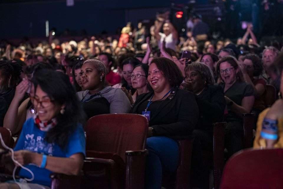 Members of the audience laughed and cheered at a joke during the She The People Presidential Forum at Texas Southern University in Houston.