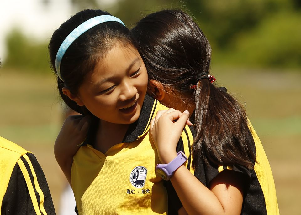 Students embraced during a ceremony at the school in August.