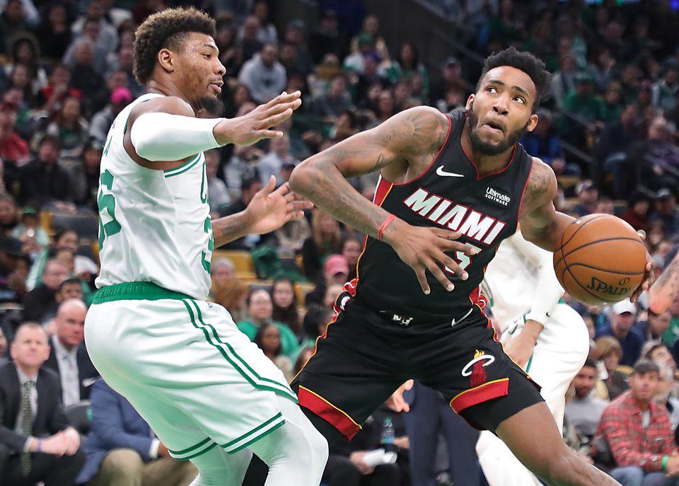Marcus Smart (left) guards Miami's Derrick Jones Jr. during the third quarter.