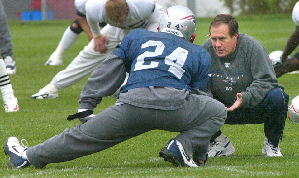 Coach Bill Belichick confers with Ty Law before a game in 2004, Law's last season with the Patriots.