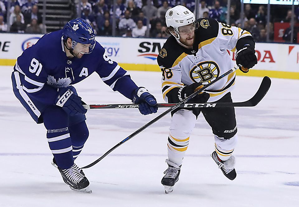 Toronto's John Tavares (left) jousted with David Pastrnak in Game 6 Sunday.