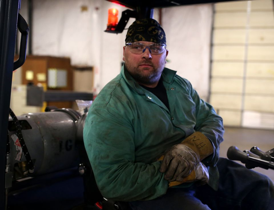 Welder Jason Burr prepares to drive a forklift inside the plumbing shop at Cannistraro's fabrication facility in Wilmington.