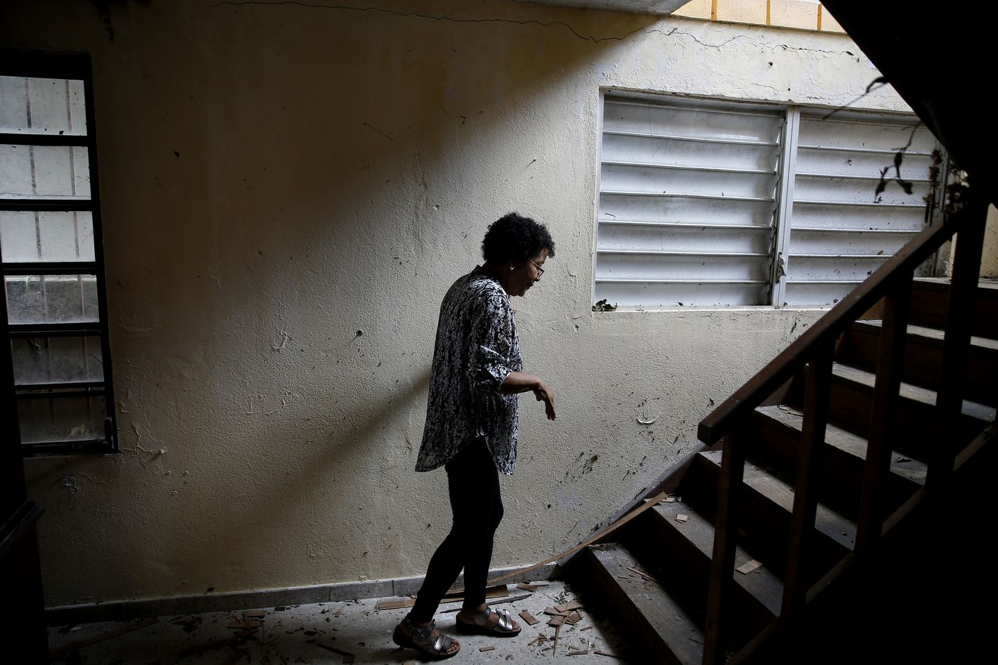 After her husband's funeral service Ana Ruiz returned to her home, where the couple had lost everything on the first floor and much of what was on the second.