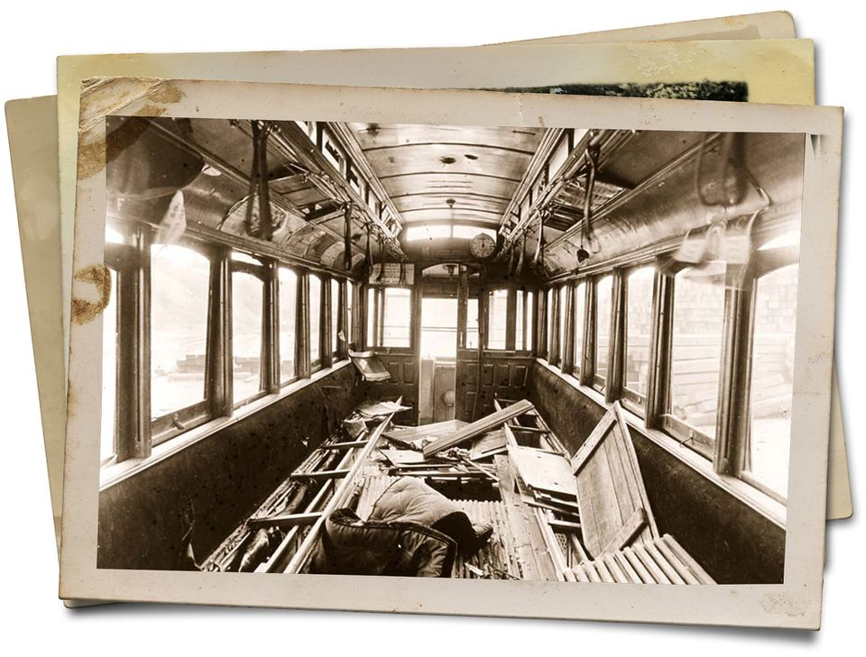 The view inside the 25-foot passenger compartment of Car 393 after it was dredged from the bottom of Fort Point Channel. The damage shows evidence of the passengers' struggle to escape the submerged car in the dark.