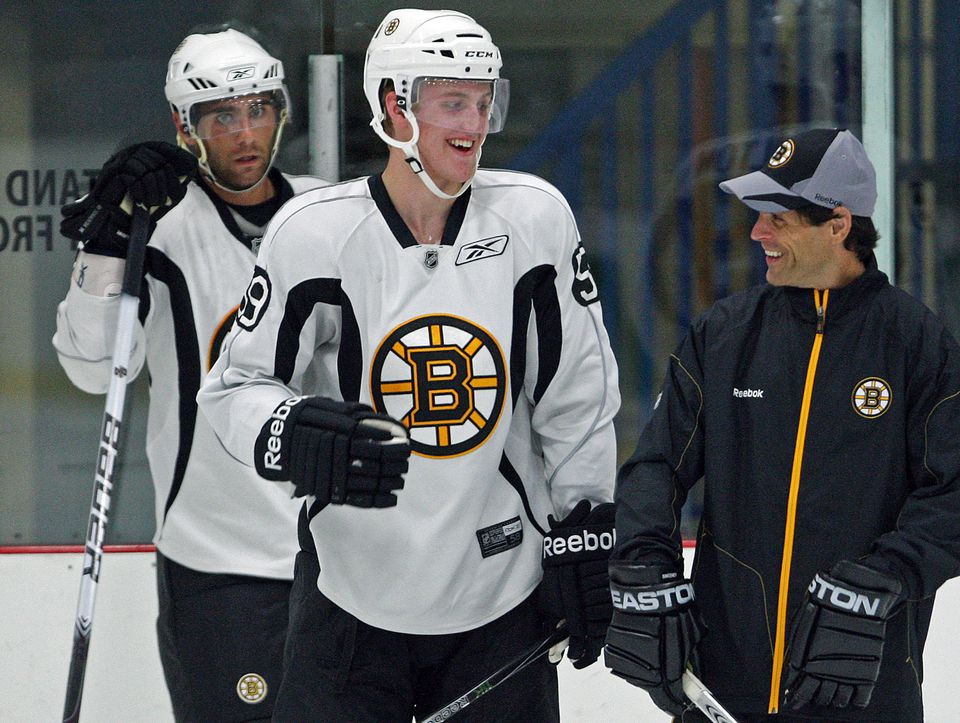Don Sweeney (right, in 2011) played most of his NHL career in a Bruins uniform.