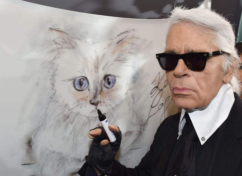 "Mr. Lagerfeld posed next to a painting of his cat ""Choupette"" during the inauguration of the show ""Corsa Karl and Choupette"" at the Palazzo Italia in Berlin."
