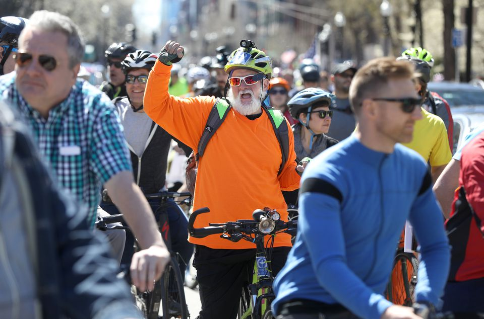 On Boylston Street Sunday, Jim Tozza, of Saugus, danced on his bike to piped music.