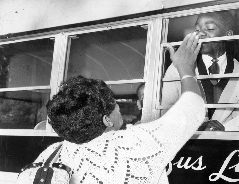 In 1966, Joan McLarin says goodbye to her eighth-grade son, Milton, 13, as his bus leaves from Seaver and Harold streets in Boston for Braintree Junior High School as part of the Metco program.