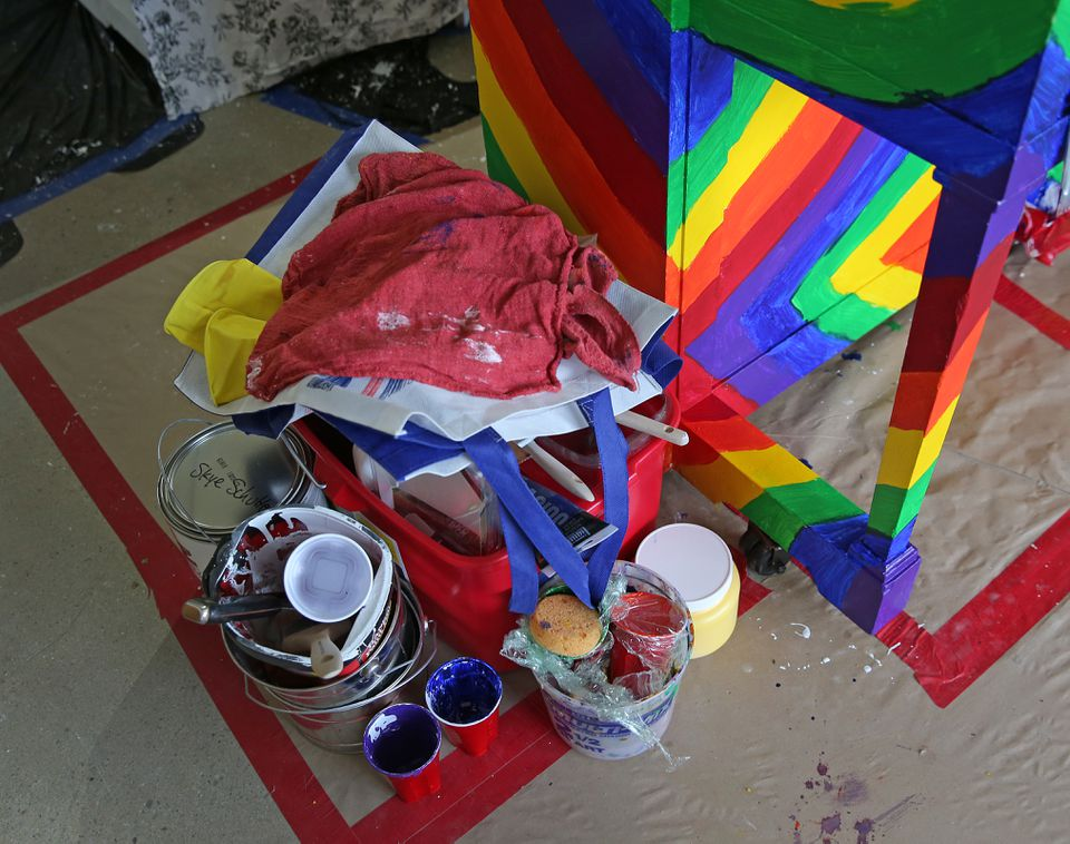 The tools of the trade are seen near a colorfully decorated piano.