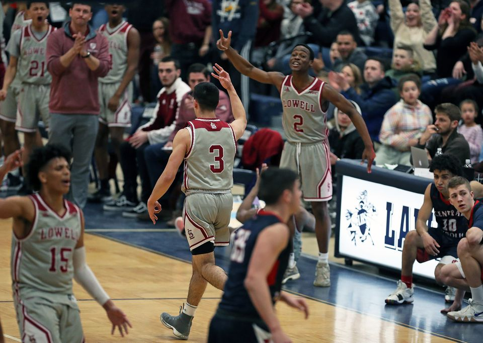 Lowell's Carlos Nunez (3),, who scored a team-high 22 points, reacts after hitting a first-quarter 3-pointer, one of three he hit in the opening frame.