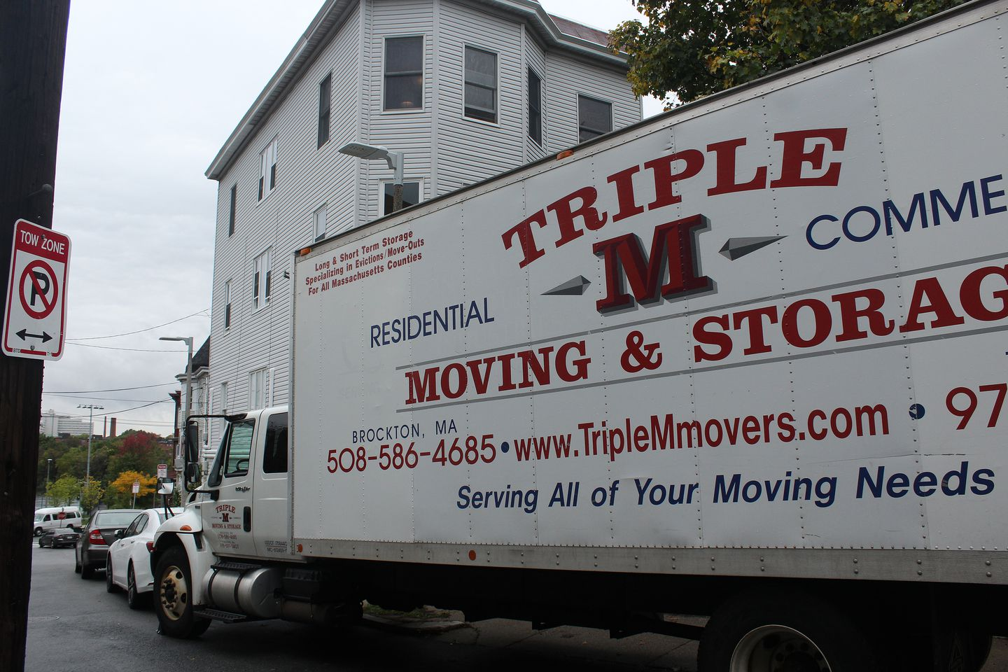 """The small type on a moving truck that arrived at Jerome Stanley's longtime home says """"Specializing in Evictions/Move-Outs."""""""