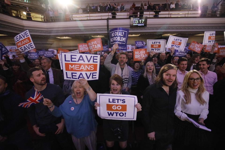 Pro-Brexit activists held placards at a political rally titled 'Lets Go WTO,' hosted by Leave Means Leave in London on Thursday.