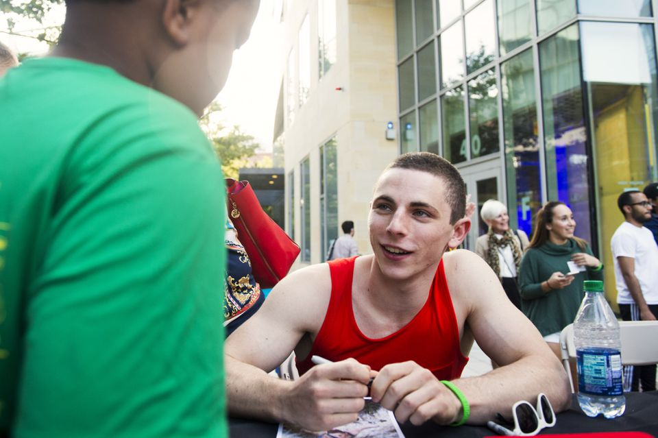 """Josh Levin signs autographs at an """"American Ninja Warrior"""" watch party at the Northeastern University Visitor's Center."""