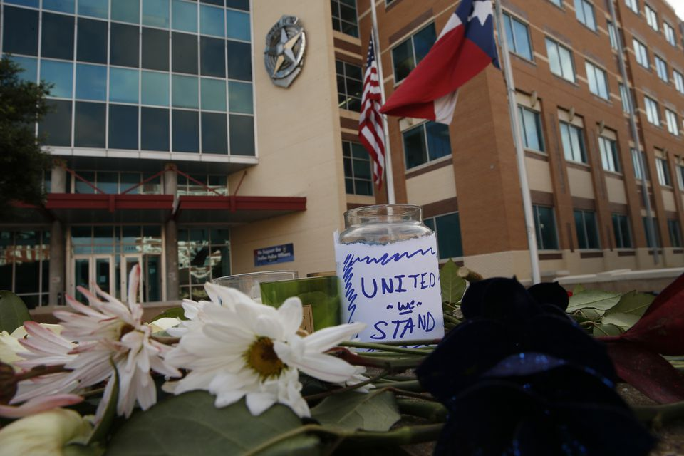 Flowers placed outside Jack Evans Police Headquarters in Dallas on Friday.