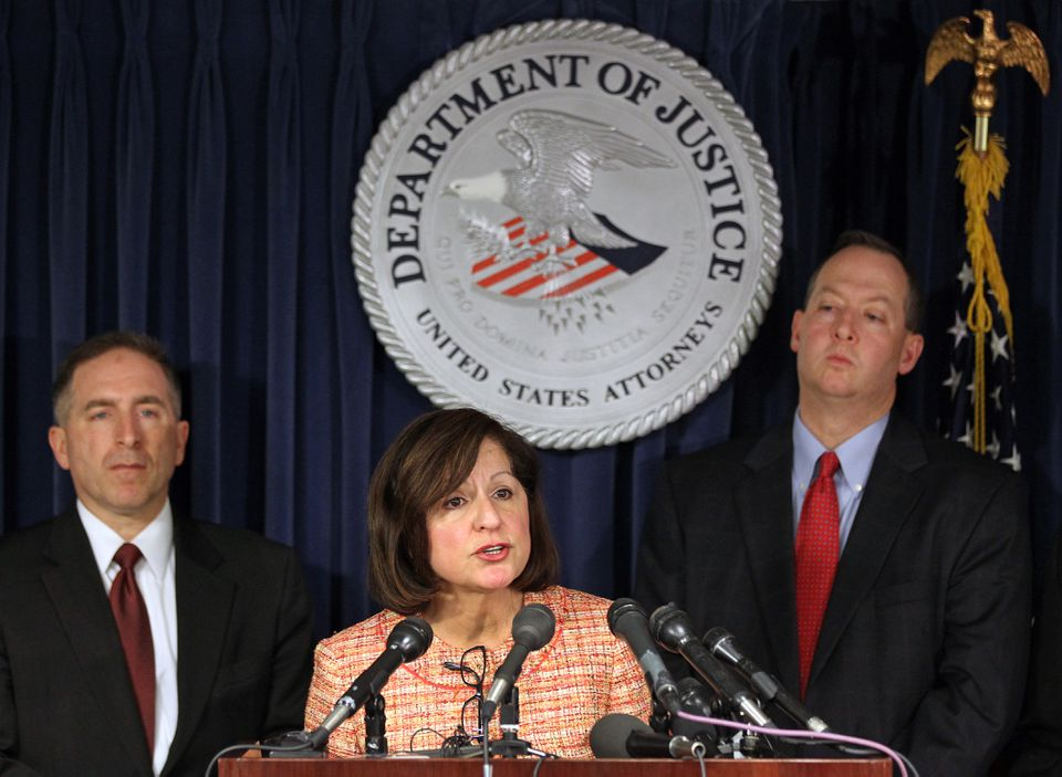 US Attorney Carmen M. Ortiz (center) announced indictments for three former top probation officials at the Moakley Federal Courthouse on Friday. FBI ASPC James Burrell (left) and Chief of Public Corruption Brian Kelly (right) joined her.