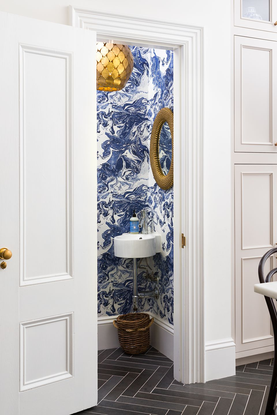 Inspired by wallpaper in her parents' California home, Garlough chose an abstract pattern for the powder room off the kitchen.