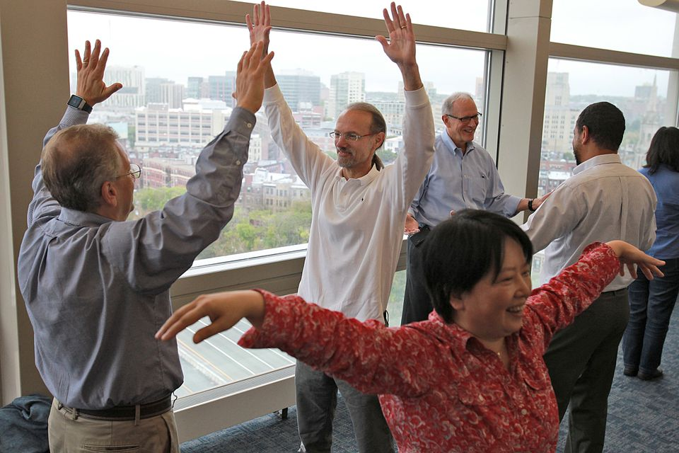 From left, Boston University scientists Azer Bestavros, Mark Grinstaff, and Xin Zhang during an improvisational training session.