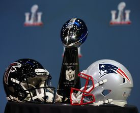 The Lombardi Trophy and the Patriots and Falcons helmets were on display during a Wednesday news conference in Houston.
